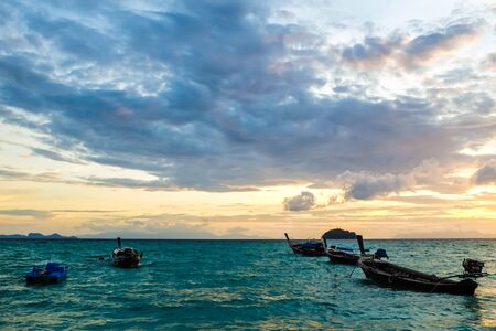 fishery: Sunrise at ocean with fishery boat in Lipe, Thailand