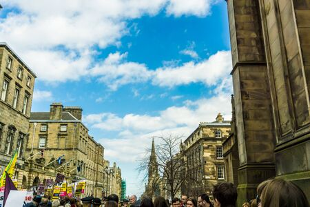 succession: EDINBURGH SCOTLAND MARCH 20: People on The Royal Mile is a succession of streets which form the main thoroughfare of the Old Town of the city of Edinburgh in Scotland on march 20, 2016