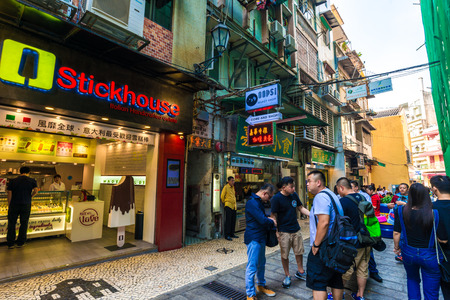tourism industry: MACAU, CHINA - OCT 22: Visitors visit the famous souvenir street in Macau on October 22, 2015. Chinese tourists are the main resource in Macau tourism industry now.
