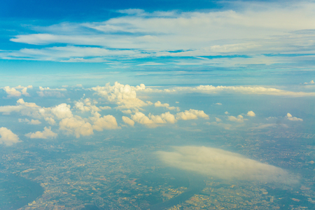 the mainland: Sky with clouds view from airplane can see mainland of Bangkok, Thailand
