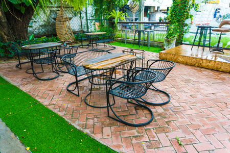 hang out: table and chairs in park outdoor at cafe and hang out bar