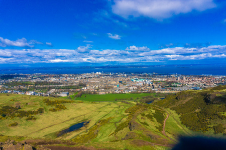 edinburgh background: The Edinburgh skyline with blue sky in the background. Photographed from Calton Hill.