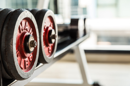 exert: Selective focus on Dumbbell in fitness and gym room interior sport object Stock Photo