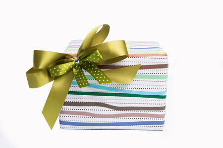 luxery: Wrapped luxery gift box with green gold ribbon bow on white