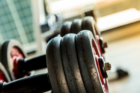 sport object: Selective focus on Dumbbell in fitness and gym room interior sport object Stock Photo
