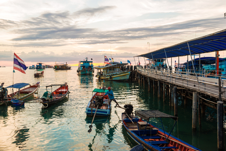 koh tao: Sunset over a row of fishing boats on Koh tao beach in Thailand, Transport boat