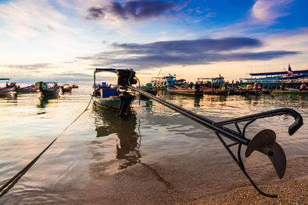 tao: Fishing and transport boat on Koh Tao beach warm light sunset time, Thailand Stock Photo