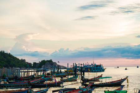 koh tao: Fishing and transport boat on Koh Tao beach warm light sunset time, Thailand Stock Photo
