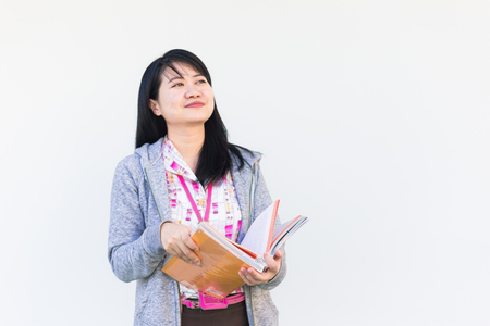 office uniform: Portrait of asian beautiful woman wear office uniform reading a book outdoor Stock Photo