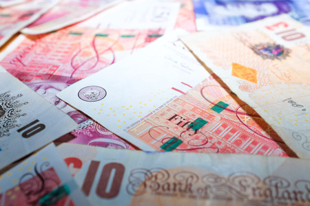 Selective focus of pound money business finance, making money concept.