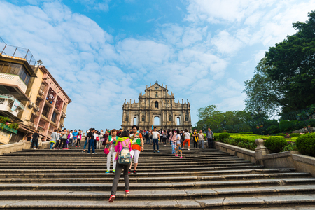 known: MACAU, CHINA - OCT 22: Visitors visit the Ruins of St. Pauls. Built from 1602 to 1640, one of Macaus best known landmarks. In 2005