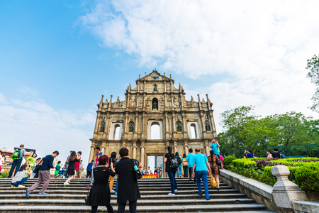 known: MACAU, CHINA - OCTOBER 22, 2015: Tourist with The ruins of St. Pauls. Built from 1602 to 1640, one of Macaus best known landmarks. Part of the Historic Centre of Macau, a UNESCO World Heritage Site. Editorial