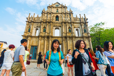 MACAU, CHINA - OCT 22: Visitors visit the Ruins of St. Pauls. Built from 1602 to 1640, one of Macaus best known landmarks. In 2005