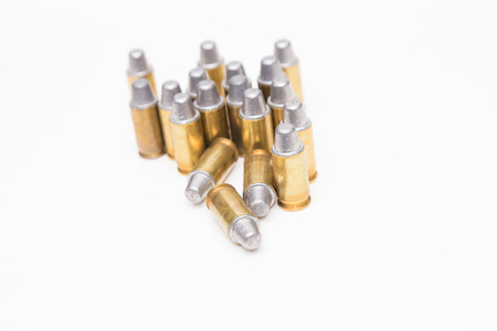 caliber: Group of caliber bullets pistols ammo isolated on a white background.