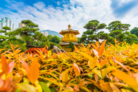 lian: Golden Pavilion of Absolute Perfection in the Nan Lian Garden with tree blue sky, Hong Kong. Stock Photo