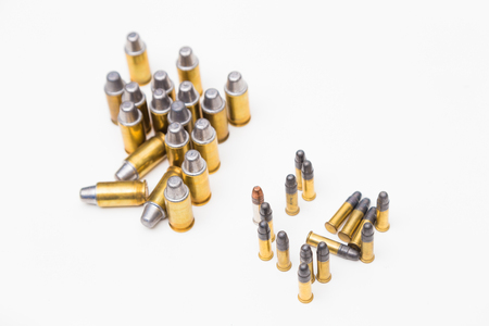 45 caliber: Set of .45 and .22lr cartridges pistols ammo on white background