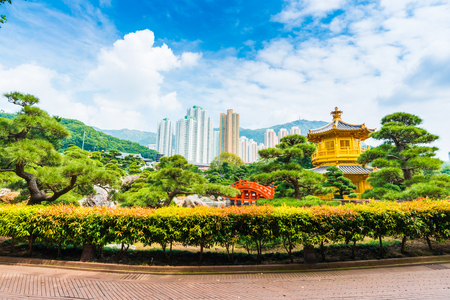 absolute: The Golden Pavilion of Absolute Perfection inside Nan Lian Garden with green tree background. Hongkong Stock Photo
