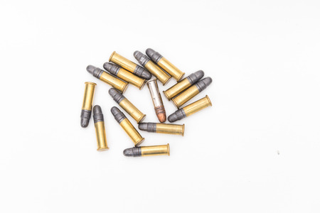 caliber: Small caliber ammunition in a pile on white background Stock Photo