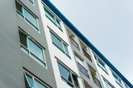 Typical lowrise apartment building in urban area, Balconies of residential building Stock Photo