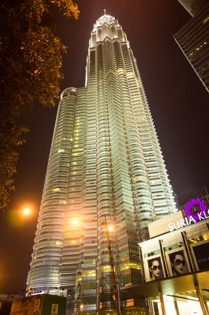 twin tower: KUALA LUMPUR - OCT 25: The Petronas Twin Towers with Suria KLCC on October 25, 2014, in Kuala Lumpur, Malaysia are the worlds tallest twin tower. The skyscraper height is 451.9m
