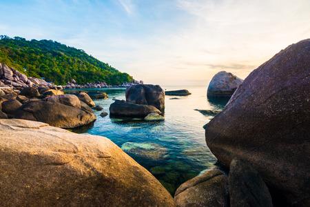 VAcationa time concept idyllic sea rocky beach with mountain sunrise, Kohtao, Thailand Stock Photo