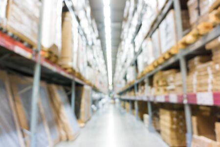 supplychain: Warehouse inventory in defocus store blur background modern style. Stock Photo