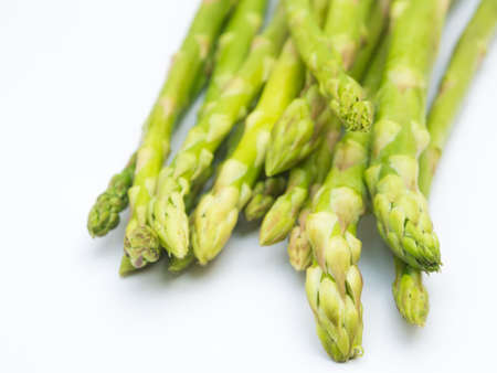 nutritiously: Fresh asparagus low calorie food on white, healthy object