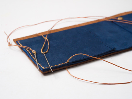 craftmanship: Craftsmanship of old handmade leather wallet isolate on white background