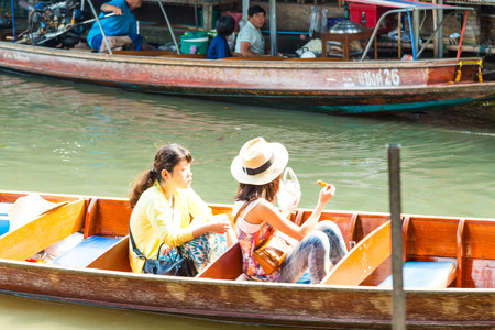 RATCHABURI, THAILAND-MARCH 20: Damnoen Saduak Floating Market on March 20,2016 in Thailand. Having many small boats laden with Souvenir shop, colourful fruits, vegetables and Thai cuisine.