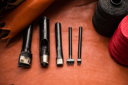 Flat lay of Leather crafting tool on skin product of genuine leather