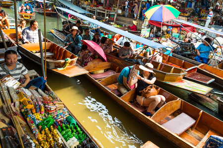 Damnoen Saduak, Thailand-20 March 2016. Busy sunday morning at Damnoen Saduak floating market,Ratchaburi Thailand place of locals selling fresh produce, cooked food and souvenirs. Editorial