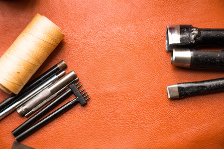 Top flat lay view of craftsman ship tool work space to skin leather products Banco de Imagens