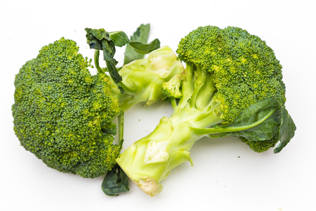 Broccoli organic vegetable close up isolated on white background Stock Photo
