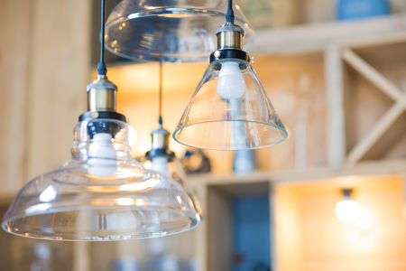 Vintage lighting lamp decor with retro filter effect in cafe shop