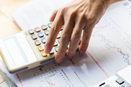 calculating: Hand of business man entrepreneur calculating and reviewing investment plan, Businessman Working