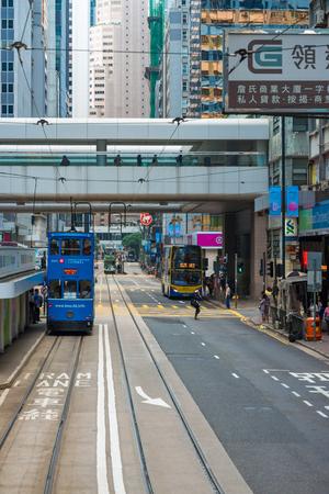 tramline: Hong Kong, China - October 25, 2015: Hong Kong Tramways , The trams run on a double track tramline built parallel to the northern coastline of Hong Kong Island.