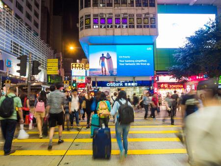 HONG KONG - OCT 22: Tsim Sha Tsui at night on October 2, 2015 in Hong Kong. Tsim Sha Tsui is a major tourist hub in metropolitan Hong Kong, with many high-end shops and restaurants