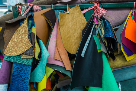 vesicle: Bundle of artificial genuine cow leather variety shades of colors in shop, Craftsmanship industry