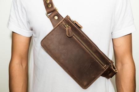 Men wear handmade of brown genuine leather belt bag on white