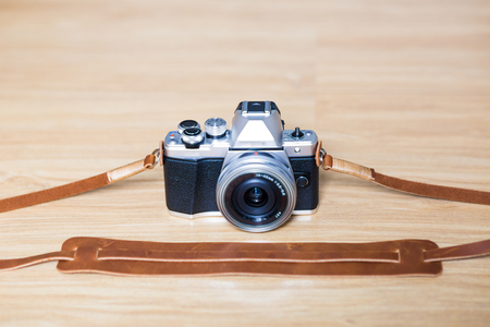 olympus: Genuine leather camera strap handmade with mirrorless camera on wooden table