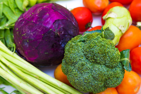 Variety many color of fresh vegatables on white