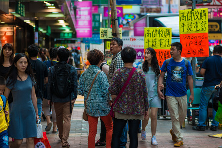 HONG KONG - OCT 24: People shopping at Mong kok on October 24, 2015 in Hong Kong. Mong kok is characterized by a mixture of old and new multi-story buildings, with shops and restaurants at street level.