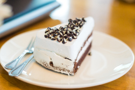 fattening: Delicious white cake with chocolate on disk