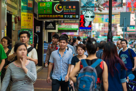 characterized: HONG KONG - OCT 24: People shopping at Mong kok on October 24, 2015 in Hong Kong. Mong kok is characterized by a mixture of old and new multi-story buildings, with shops and restaurants at street level.