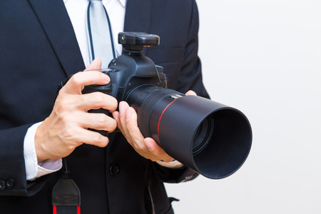 Business man with dslr camera in black suit close up, Professional photographer Stock Photo