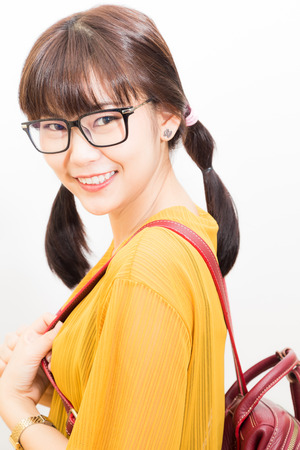 Eyeglasses beautyful student asian women with bag on white background Stock Photo