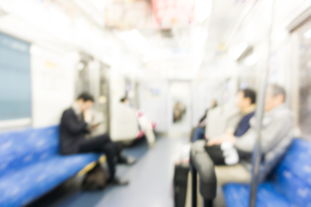 People move in the the subway train blurred background. Motion blur. City life.