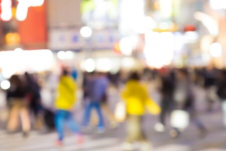 scramble: Night life at Shibuya street many people in Tokyo Japan on blur background Stock Photo