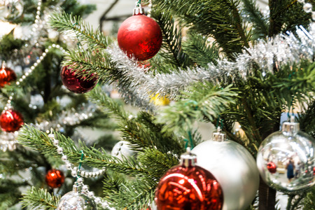 Christmas ball with in pine tree decoration with background lights Stock Photo