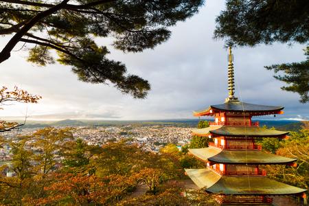 sengen: Mount Fuji and Chureito Pagoda at sunrise in colourful autumn forest. Chureito pagoda is located near Fujiyoshida train station, Japan.